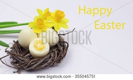 Easter Eggs. Happy Easter Card. Easter Eggs On A White Wooden Background. Easter Background. Easter