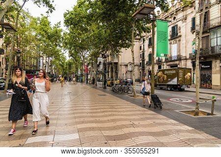 Barcelona, Spain - July 31, 2019: People Walking Along La Rambla Street