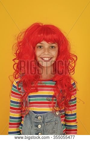 Ready For Super Party. Party Girl Yellow Background. Happy Child Wear Red Colored Party Wig. Perfect