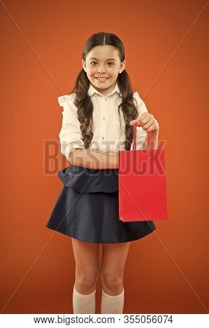 Girl Holding Shopping Bag. Prepare For School Season Buy Supplies Stationery Clothes In Advance. Sch