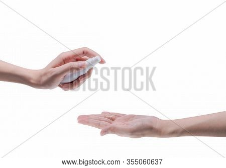 Woman Hand Hold Alcohol Bottle And Spray On Palm To Protect And Kill Coronavirus And Cleaning Hand.