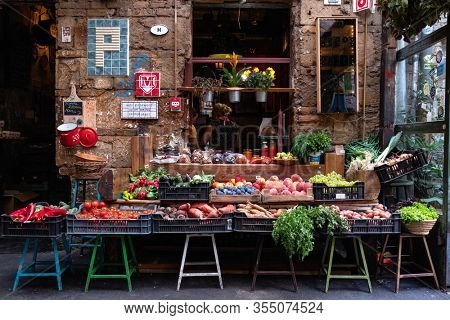 Budapest, Hungary - August 25, 2019: Farmers market with organic fruits and vegetables in Szimpla Garden ruin bar, popular spot for locals and tourists in Budapest