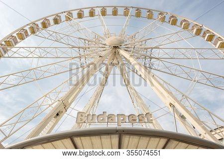 Budapest, Hungary - August 25, 2019: Market ferris wheel Budapest Eye in Budapest, Hungary