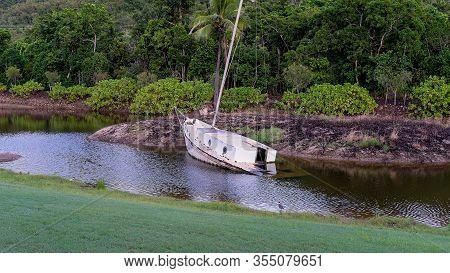 A Sunken Yacht In A Small Lake Now Used As Landscape Decoration