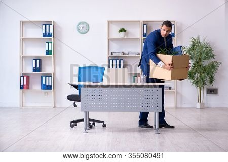 Young employee being made redundant