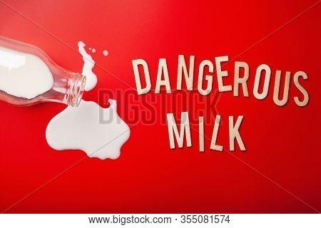 dangerous milk word text letters lactose intolerance allergy. milk splatter. avoid dangerous dairy