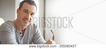 Template portrait of smiling middle-aged guy