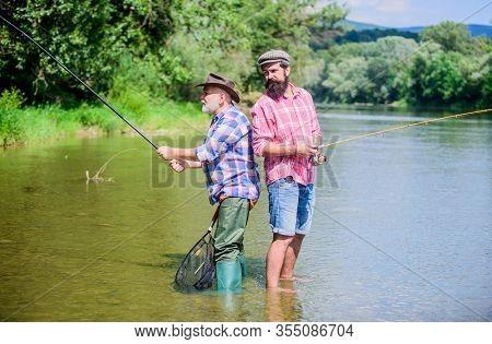 Fisherman Fishing Equipment. Fisherman Grandpa And Mature Man Friends. Father And Son Fishing. Fishe