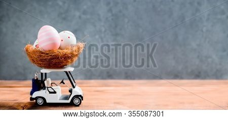 Happy Easter. Colorful Painting Eggs On Golf Car For Celebrate In April.