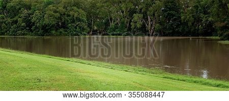 A Small Creek Overflows Its Banks Due To Heavy Tropical Rainfall