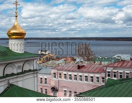 Golden Dome Of Church Of The Nativity Of John The Baptist, Old Building And Volga River In Nizhny No