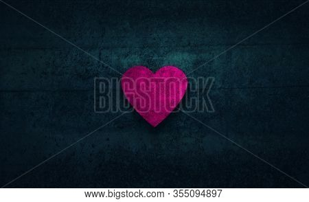 Pink heart shape on textured background