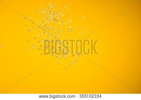Freeze Motion Of Flying Uncooked Pasta On Yellow Background, Food Concept.
