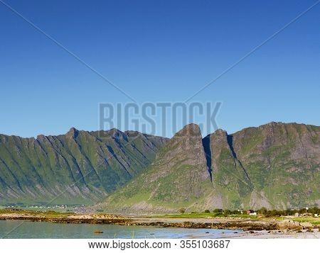 Coast Of Gimsoya Island, Gimsoysand Sandy Beach And Mountains. Nordland County, Lofoten Archipelago