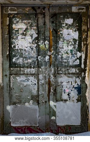 All Forgotten And Shabby Door To The House .