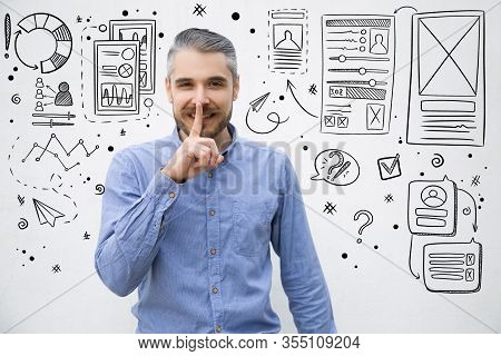 Handsome Young Man Gesturing Silence. Hand Drawn Business Sketches With Cheerful Stylish Guy Holding