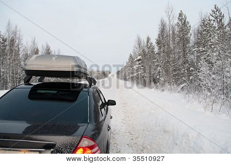 Car Trip In Winter Snowy Road In Northern Forests