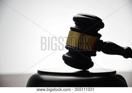 Judge Hitting Gavel On White Background, Closeup