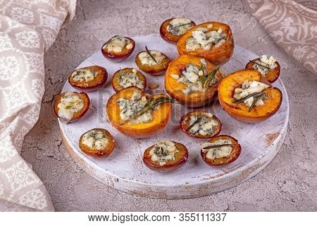 Grilled Baked Peach And Plums Stuffed With Blue Cheese Dorblu And Rosemary. Top View