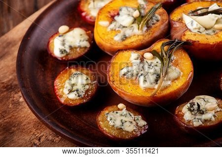 Grilled Baked Peach And Plums Stuffed With Blue Cheese Dorblu And Rosemary. Top View. Copy Space