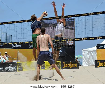 HERMOSA BEACH, CA - JULY 21: Brad Keenan, Mark van Zwieten and Andrew Fuller compete in the Jose Cuervo Pro Beach Volleyball tournament in Hermosa Beach, CA on July 21, 2012.