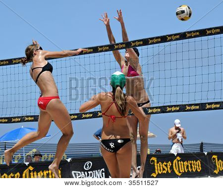 HERMOSA BEACH, CA - JULY 21: Michelle Moriarty, Morgan Beck and Kaitlin Sather compete in the Jose Cuervo Pro Beach Volleyball tournament in Hermosa Beach, CA on July 21, 2012.