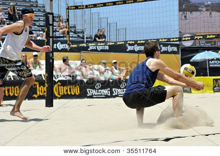 HERMOSA BEACH, CA - JULY 21: John Mayer and Brad Keenan compete in the Jose Cuervo Pro Beach Volleyball tournament in Hermosa Beach, CA on July 21, 2012.