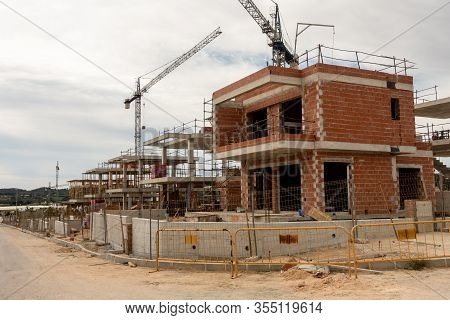 New Homes Under Construction On Spanish Urbanisation With Cranes