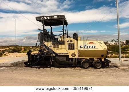 Torrevieja, Valenciana, Spain - Mar 01 2020 : Chm Heavy Weight Road Laying Vehicle Parked In Spanish