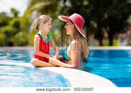 Mother, Child At Swimming Pool. Mom And Kid Swim.
