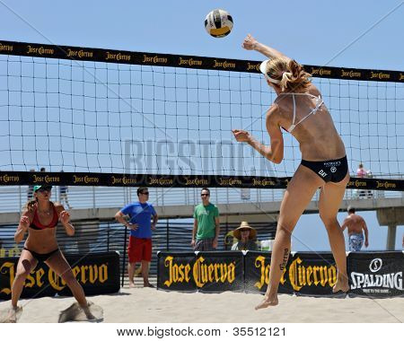 HERMOSA BEACH, CA - JULY 21: Sarah Day and Michelle Moriarty compete in the Jose Cuervo Pro Beach Volleyball tournament in Hermosa Beach, CA on July 21, 2012.