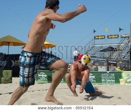 HERMOSA BEACH, CA - JULY 21: Bartosz Bachorski and Danko Iordanov compete in the Jose Cuervo Pro Beach Volleyball tournament in Hermosa Beach, CA on July 21, 2012.