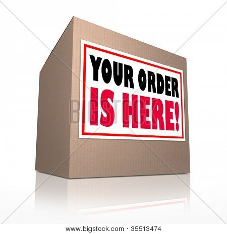 A cardboard box delivered with the words Your Order is Here to tell you that the merchandise you shopped for at a store has been shipped and is waiting for you to open it