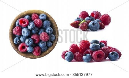 Ripe Berries Isolated On White Background. Blueberries, Wild Strawberries And Raspberries. Mix Berri