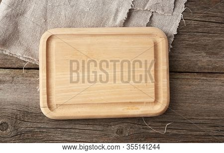 Light Beige Rectangular Empty Cutting Kitchen Board On A Wooden Background From Old Boards, Top View