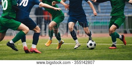 Soccer Football Player Dribbling A Ball And Kick A Ball During Match In The Stadium. Footballers In