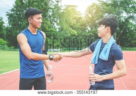 Two Friends Runners Greeting Each Other Handshaking At The Stadium Running Track - Runners Shake Han
