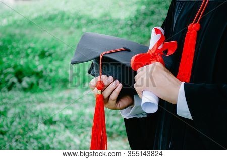 Graduation,student Hold Hats And Diploma In Hand During Commencement Success Graduates Of The Univer
