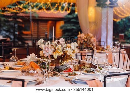 Table In Outdoor Tent Evening. Wedding Decor For A Banquet.