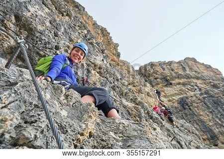 Woman Smiling On Via Ferrata Cesare Piazzetta To Piz Boe Peak, Dolomites Mountains, Italy. Summer Ad