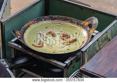 Vietnamese Sizzling Shrimp Pancake At Street Food Vendor