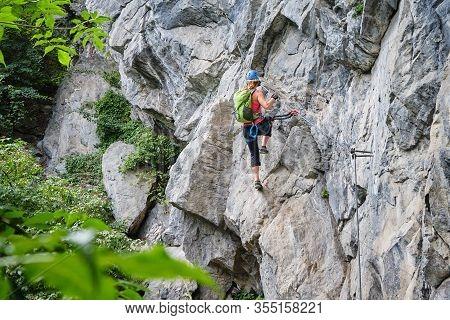 Woman Climbing Via Ferrata Zimmereben, Near Mayrhofen, Zillertal Valley, Austria.