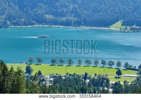 Cruise Ship On Achen Lake (achensee), Austria, On A Sunny Summer Day - View From An Elevated Vantage