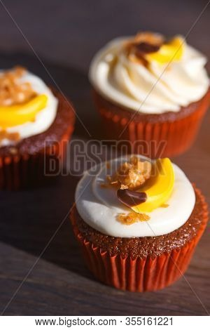 Delicious Easter Cupcakes On Table. Tasty Chocolate Cupcakes. Holiday Easter Card. Cupcakes With Cre
