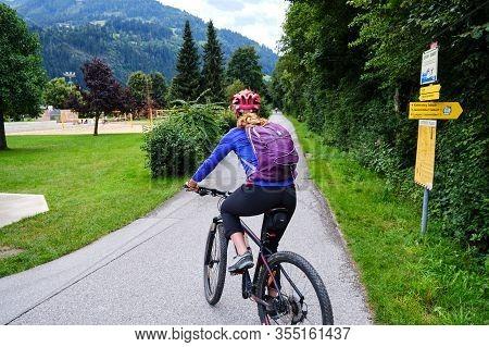 Zillertal, Austria - August 20, 2019: Woman On A Bike Route In Zillertal Valley, Austria.