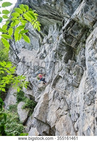 Woman Climbing Impressive Rock Formations On Difficult Via Ferrata Route Called Zimmereben, Near May