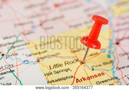 Red Clerical Needle On A Map Of Usa, Arkansas And The Capital Little Rock. Close Up Map Of Arkansas