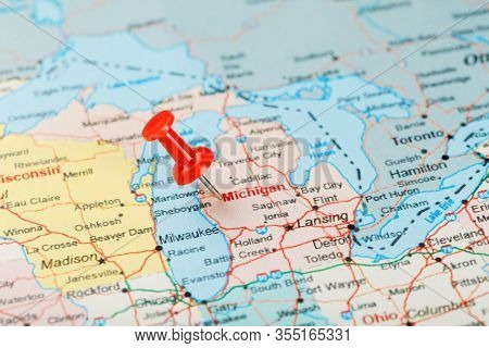 Red Clerical Needle On A Map Of Usa, Michigan And The Capital Lansing. Close Up Map Of Michigan With