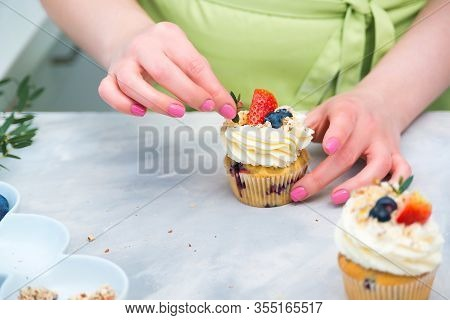 Homemade Pastry. Woman Cooking Cakes. Tasty Birthday Cupcake On Table. Confectioner Decorate Cupcake