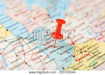 Red Clerical Needle On A Map Of Usa, Indiana And The Capital Indianapolis. Close Up Map Of Page Prot